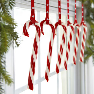 hanging candy canes in a window
