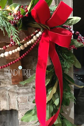 simple loop bows made of red outdoor velvet ribbon