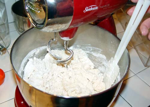 mixing cookie dough for ornaments