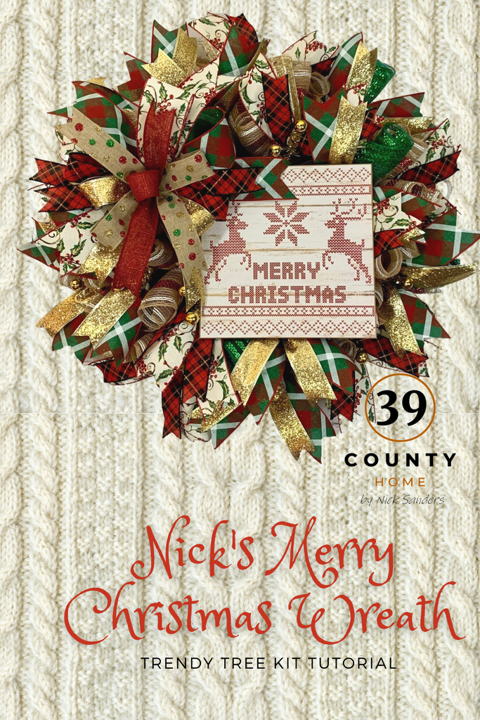 merry christmas wreath with sweater print sign