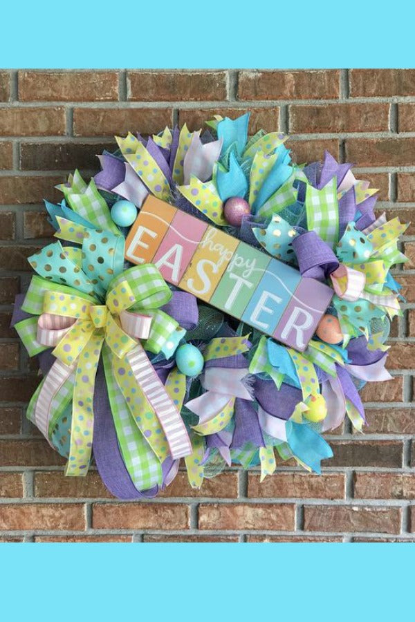 Brighten up your front door by displaying this beautiful Spring wreath with a colorful welcoming flower pot sign.