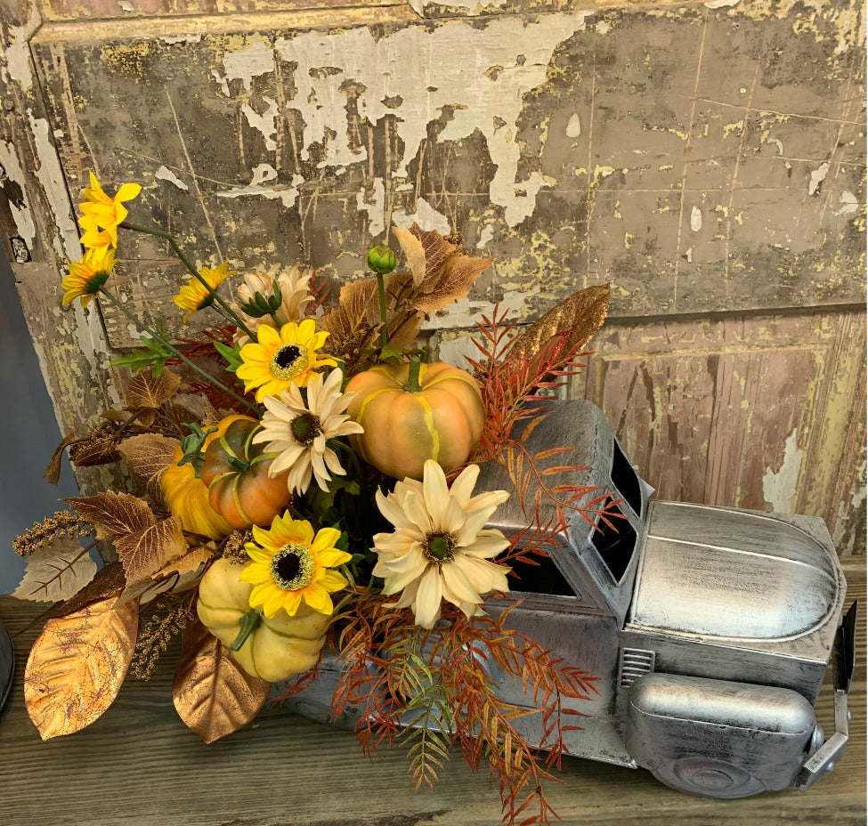 old pickup truck planter, truck container, galvanized silver truck
