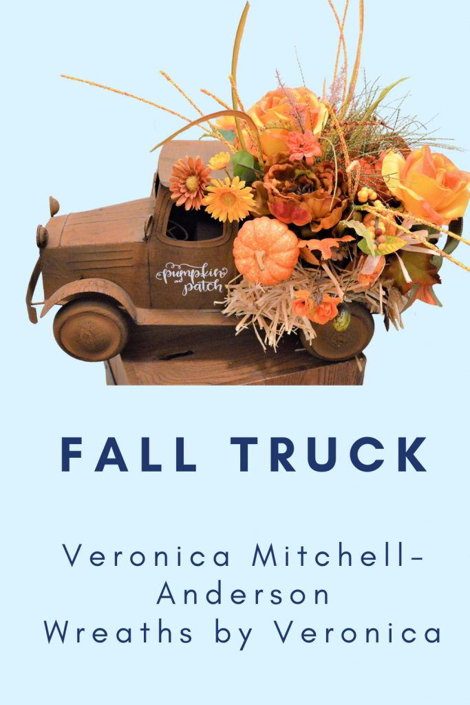 truck with pumpkins floral arrangement