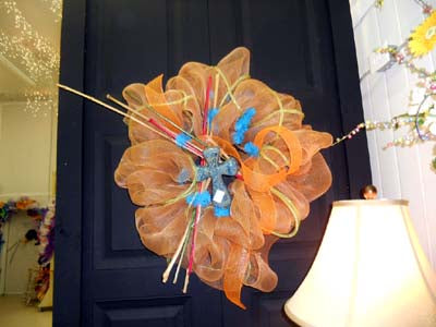 srping wreath in orange and blue