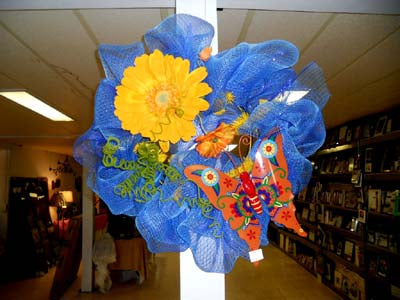 spring wreath in blue yellow butterfly flowers
