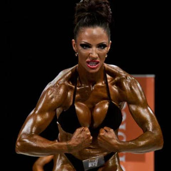 Photograph of model and bodybuilder Jodie Marsh tanned and flexing in a competition