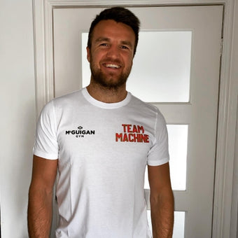 Photograph of Anthony Fowler wearing his white tshirt with the words