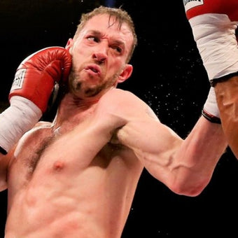 Photograph of cruiserweight champion Enzo Maccarinelli wearing red and white boxing clothes during a match