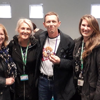 Photograph of Shaun Walsh surrounded by supporters during his battle with pancreatic cancer