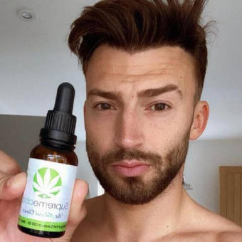 Selfie of Jake Quickenden posing with one of our Supreme CBD Oils