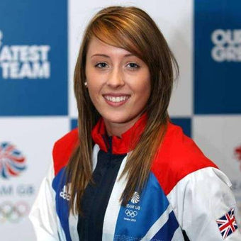 Photograph of Jade Jones wearing her Olympic suit and posing for the camera