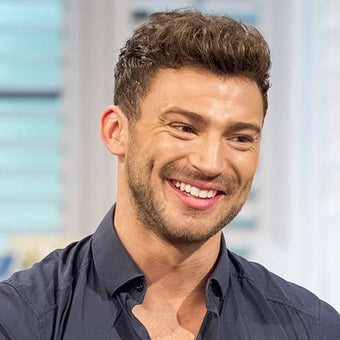 Photograph of Jake Quickenden in a black button up shirt