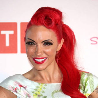 Photograph of model and bodybuilder Jodie Marsh with red hair