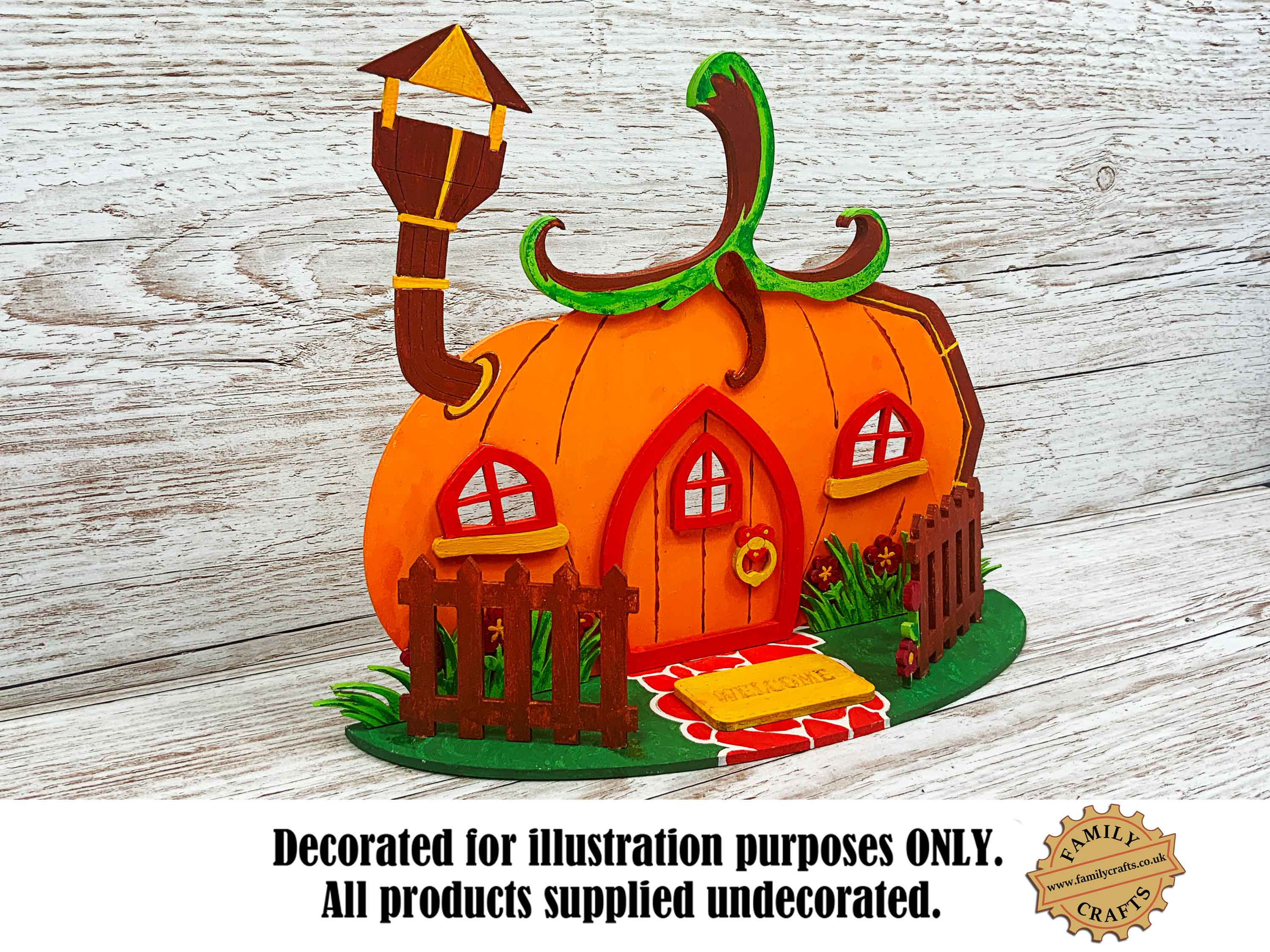 painted pumpkin fairy house view left