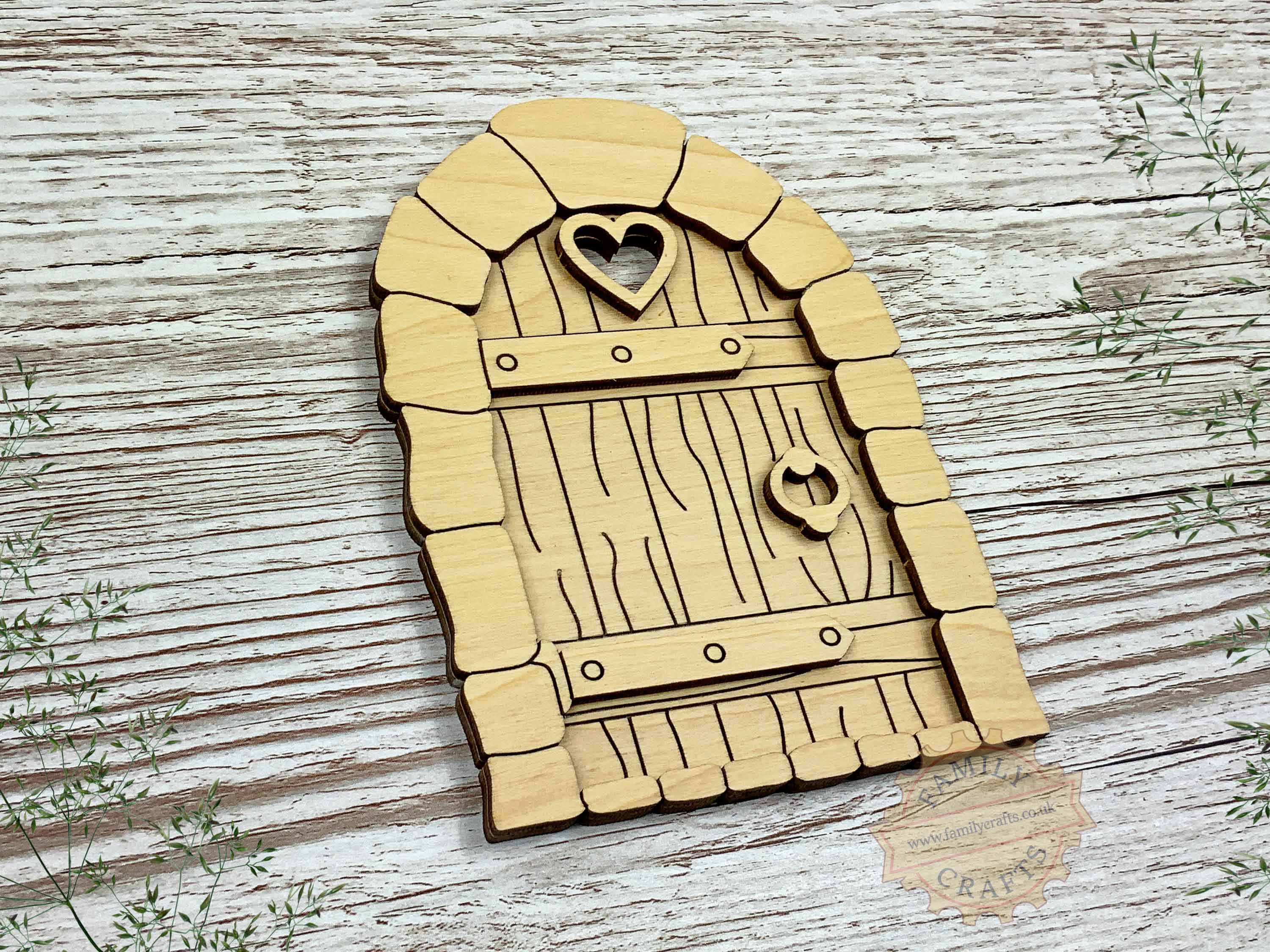 plywood cobblestone fairy door kit with woodgrain view left