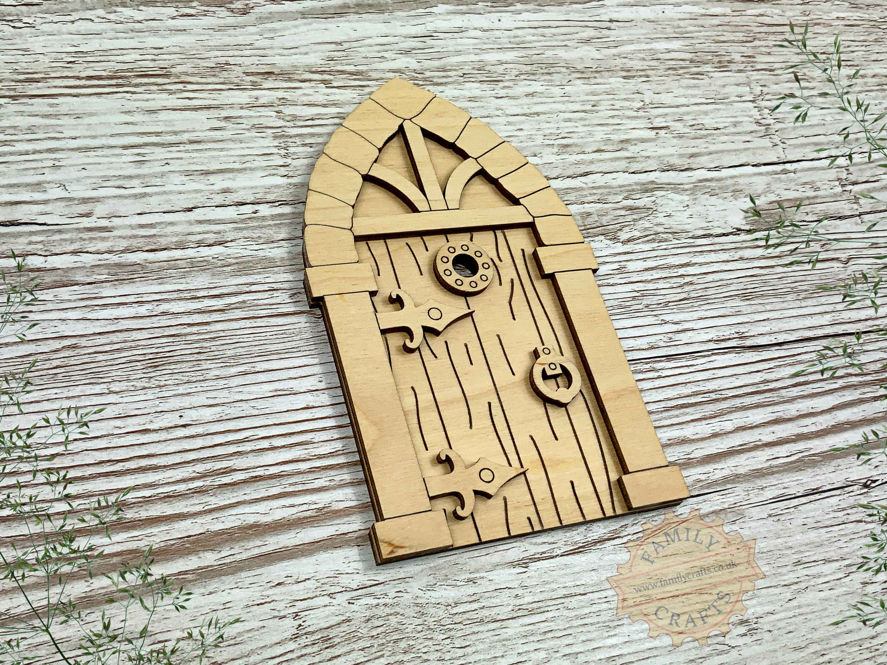 plywood medieval fairy door kit with woodgrain view left