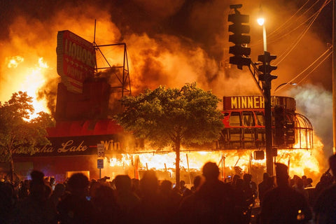 Example of people rioting in Minneapolis after the death of George Floyd. Photo Credits to Kerem Yucel/Getty Images