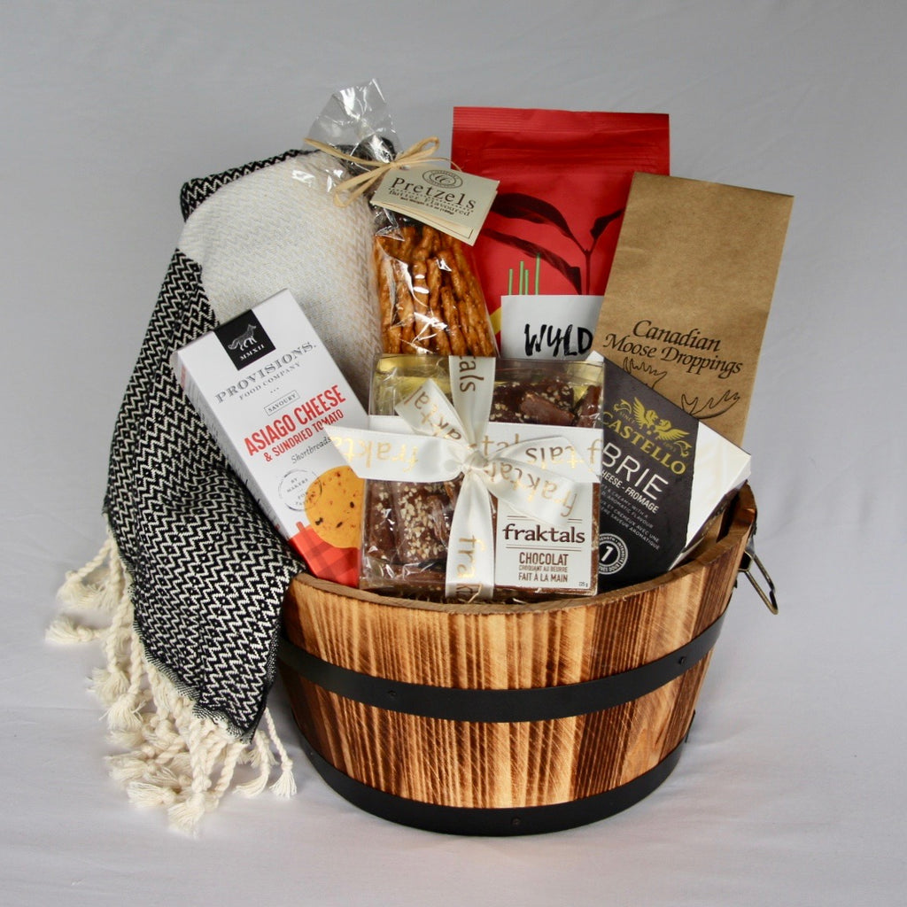 This sophisticated housewarming gift barrel is filled with top quality organic and wholesome products that are practical and will help them settle into their home with a little bit more ease. It also includes a hand-loomed organic Turkish cotton throw blanket, and a handy wooden barrel with metal handles. Making it a perfect home closing gift for your client or housewarming gift for a loved one. We are a Toronto based full service online gift basket shop with a focus on using products from local businesses.