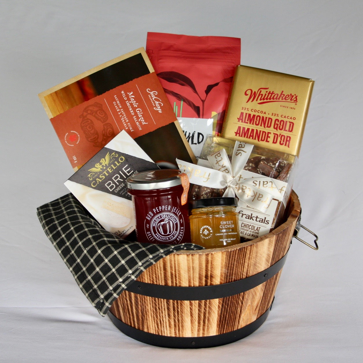 The Perfect Pairings gift basket makes the perfect gift for any occasion. This lovely wood barrel is filled with organic and wholesome products that are sure to be enjoyed by anyone. Coffee + Chocolate & Honey Glazed Smoked Salmon + Brie Cheese + Red pepper Jelly = 2 Perfect Pairings. The wood barrel and dishtowel are the perfect touch and will be cherished for years to come! We are a Toronto based full service online gift basket shop with a focus on using products from local businesses.