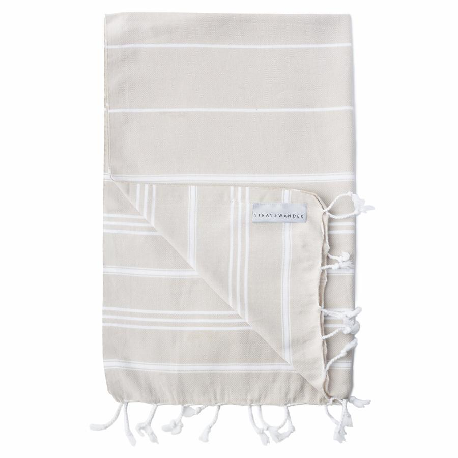 100% Hand-Loomed Organic Turkish Cotton Hand Towel 60 x 90cm in Beige & White by Toronto's Stray & Wander. Ethically sourced directly from the artisans who make them. You can find this towel in our gift baskets, or add it to your custom basket that you build right on our site!