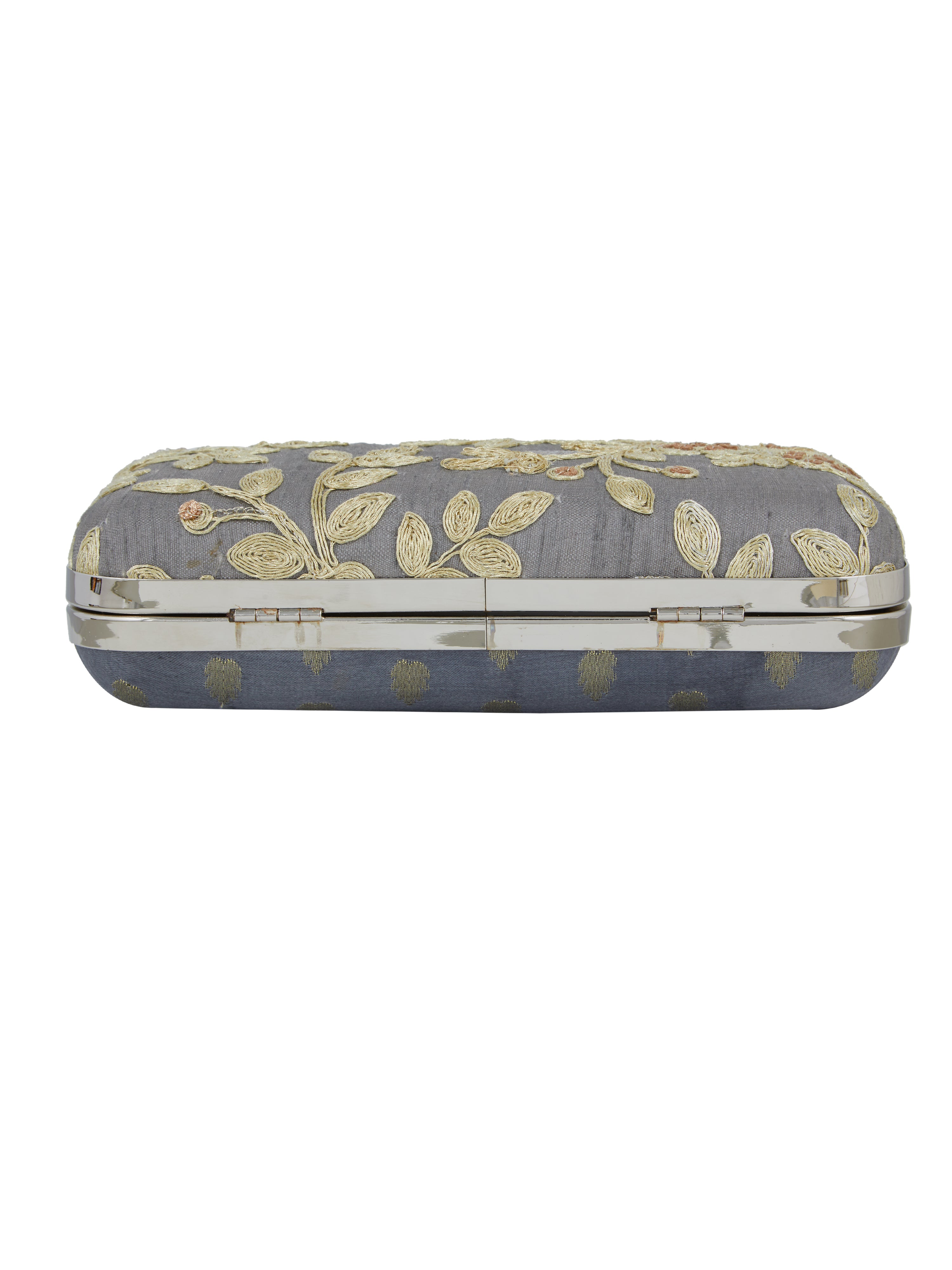Keep your stuff handy while you are on the move with this grey coloured box clutch from the house of TARUSA. Made from silk fabric, this box clutch for women will be your companion for years to come. Unique and voguish, this box clutch will go well with your casual outfits.