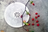 An intricately handcrafted alabaster stone multipurpose platter from Agra.   This pure white alabaster platter is beautiful and visually appealing. This sophisticated piece adds grace and charm to home decor and can be used as a display, for serving or simply as a decorative item.