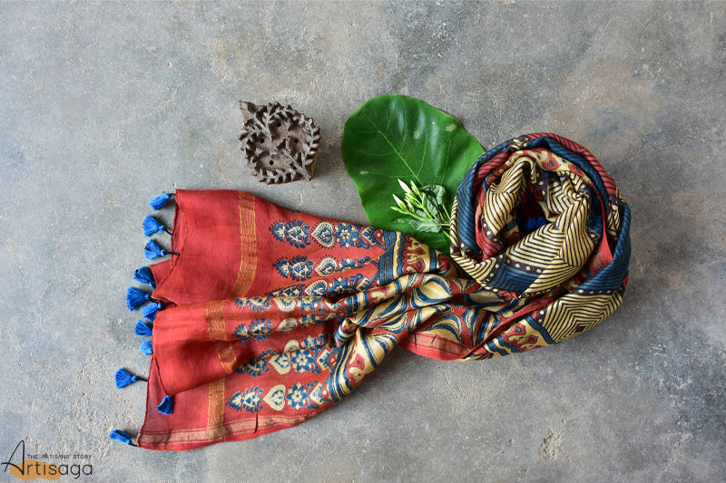 A chic looking multicoloured dupatta is hand block printed with motifs forming a diamond pattern, making it appealing to the viewer's eye. The contemporary designs of the leaf and the traditional motif of minari makes it suitable for all ages. A narrow light orange border adds a simplistic touch to this alluring piece. Pair this dupatta with a plain kurti and jutis for a classic ethnic look.