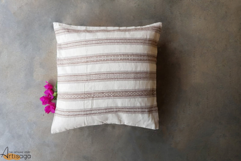 A traditionally hand woven 100% organic cotton pillow cover from Kutch, Gujarat.   Decorate your home with these colourful woven pillow cases made by the artisans of Kutch. The white background has traditionally woven brown intricate detailing in a stripped pattern.