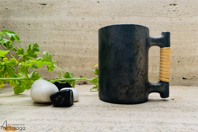 An eco-friendly earthenware clay mug of Longpi pottery from Manipur.   A thick dorset mug with a smooth and sturdy surface handcrafted to perfection by the Longpi community. The product provides a firm grip by the addition of cane coiled around the handle. Enjoy your favourite drink in this earthenware clay mug to enlighten your evenings.