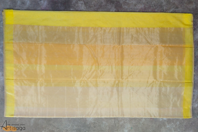 An ethereal handwoven Chanderi cotton silk saree from Madhya Pradesh.   A diligently handwoven cotton silk Chanderi saree, glistening in a vivacious yellow. The pure white and different shades of yellow create a harmonious composition. This light weight saree with a white blouse and gold jewellery is a perfect wear for summer weddings.