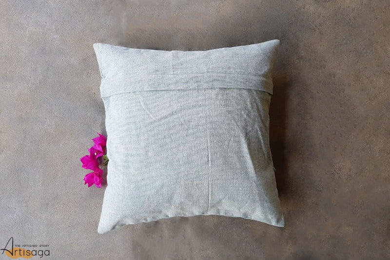 A traditionally hand woven 100% organic cotton pillow cover from Kutch, Gujarat.   A 100% organic cotton pillow cover is handwoven with the expertise of the artisans of Kutch. The cover has subtle, simple and minute details in the form of traditional kachchhi motifs in pastel yellow which adds to its texture. Hop on a cloud couch with this perfectly covered cushion by your side for a comfortable and cozy time.