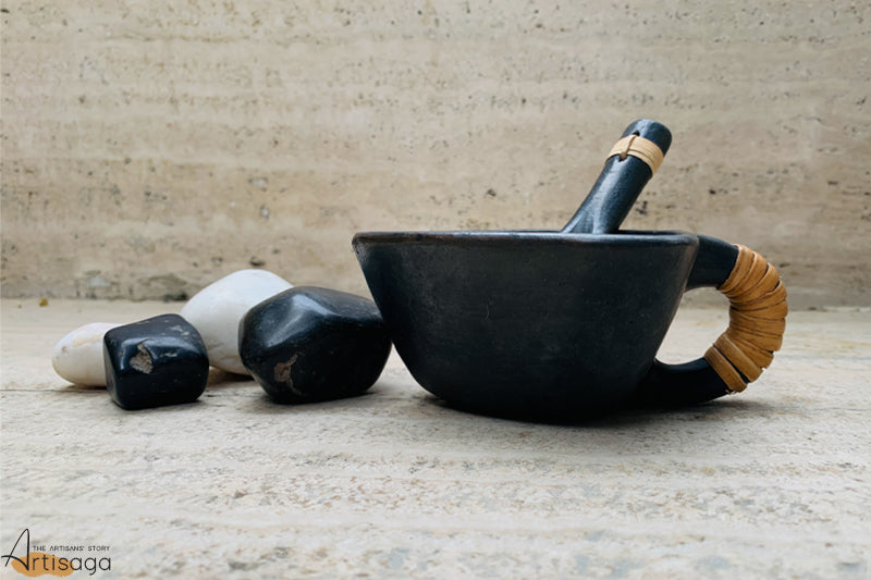 An eco-friendly earthenware clay soup bowl with a spoon of Longpi pottery from Manipur.   A chic and classy handcrafted bowl with spoon is made from the black clay originating from the hills of Manipur. The products are symbolic of the intense hard work and techniques put in by the artisan of the Longpi community. They are uniquely pleasing to the eye and can be used to have hot and exotic soups during the chilly winter evenings.