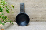 An eco-friendly earthenware clay deep frying pan of Longpi pottery from Manipur.   This matte black handcrafted deep fry pan with smooth surface helps in making food healthy while still being delicious. It is classy, elegant and majestic. The product comes with a built-in handle which is sturdy and has a strong grip. Fry your favourite finger chips and nuggets for an evening snack.