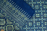 An exquisite hand block printed 100% cotton stole from Ajrakhpur, Gujarat.   This creation of colours and traditional motifs of badam butta and minari border with hand block printing depicts the blue ocean signifying miniature creatures swimming through the deep blue sea. The neon colour dipped in the blue backdrop adds a little spark to this piece and gives it a sophisticated yet dreamy look. Pair this enchanting piece with a plain white kurti to achieve an eccentric and chic look.