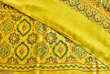 An enchanting hand block printed modal saree from Ajrakhpur, Gujarat.   The alluring beauty of yellow complimented by shades of greens and oranges, brings forth the long lasting traditions of the community. The fine combination of geometric and floral motifs gives the piece a unique touch. An excitement is added to the saree by breaking the monotony and adding a zigzag pattern along the length of the saree. Drape this saree with a backless, long sleeved blouse to give it a classic summery look.