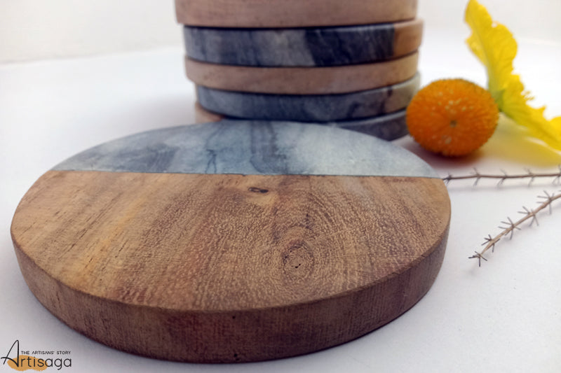 An intricately handcrafted black marble & wooden stone coasters from Agra.   This wood and stone coaster is subtle and elegant. With the shiny black marble and rustic wood, this set of six makes it worth its money. Not only do they keep the tables clean and polished, but it also adds a lot to the aesthetics of the surface and room.