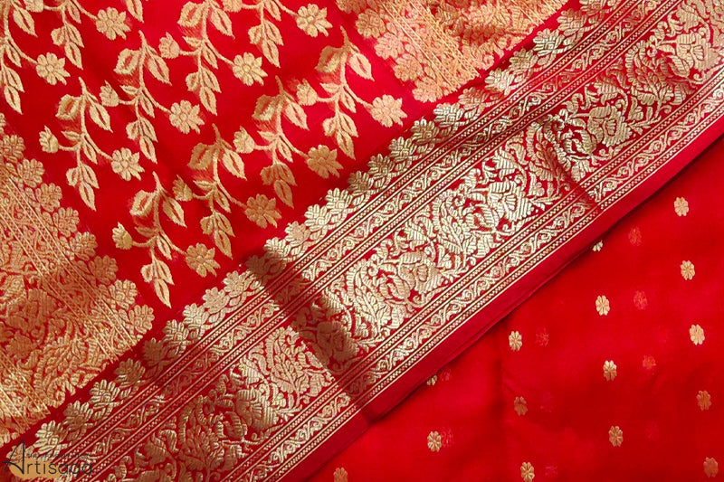 A diligently hand woven 100% Chanderi silk saree from Madhya Pradesh.   A blazing Chanderi saree hand woven in the colour of red, it is delicate yet bold and possesses an undeniable sheen. With intricate zari work throughout the saree and the minakari borders gives away a rich and powerful feel. Although heavy in work, the saree is extremely light weight and wearable. Carry this saree with a polki neck piece and a sleek braid.