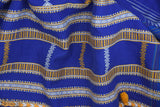 A traditionally hand woven 100% cotton stole from Kutch, Gujarat.   The classic ultramarine blue stole is a creation of the long-lived traditions of the Kutch community. This piece is complemented with a bunch of yellow and white stripes woven at equal distances along with variations of traditional motifs and borders. This stole can be effortlessly worn on an everyday clock.