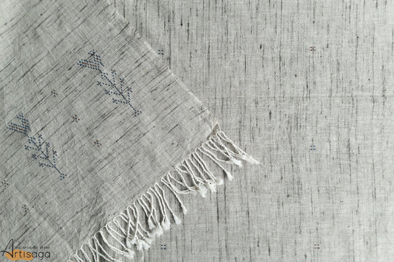 A traditionally handcrafted cotton and tussar silk stole from Kutch, Gujarat.   This aesthetically simple product of the Tangasia community is visually alluring to look at. It is made of cotton along with tussar silk and is soft to touch. The product is woven with the 'dana' peacock and button motifs which adds to the visual charisma of the piece. Pair this sophisticated stole with a gathered cotton dress and white sneakers to lead the fashion game.