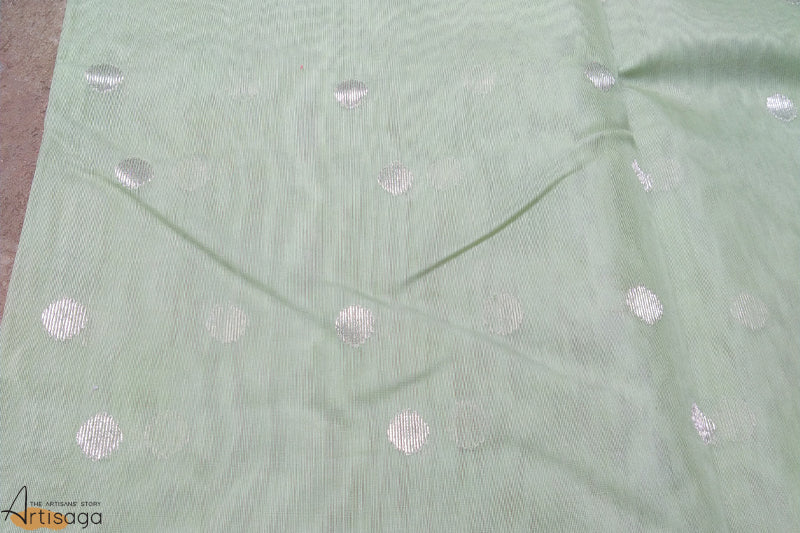 An ethereal handwoven Chanderi cotton silk saree from Madhya Pradesh.   A handcrafted cotton silk Chanderi saree woven by the diligent artisans of Madhya Pradesh. Glistening in a pastel sea green colour, subtle yet intricate motifs adds to the simplicity of the saree. Pair this glistening saree with a deep pink blouse and a white gajra for an ethnic yet chic look.