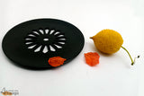 An intricately handcrafted palewa stone multipurpose platter from Agra.   This chic, curated product brings about the feeling of festivities. An ideal option for pooja, it can also serve as a decoration piece for your living spaces. The premium matte black finish and sleek stylish jaali work on the interior of the platter easily steal the spotlight.