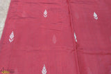 An ethereal handwoven 100% Chanderi silk saree from Madhya Pradesh.   A 100% silk chanderi saree, intricately hand woven by the artisans of Madhya Pradesh. The deep brick red is complemented well with the thin golden zari border and traditional patti motifs along the length of the saree. The gold stripes on the pallu add an element to the piece. Simple oxidized jewellery and kohl black eyes with this saree would cause an everlasting impact on the viewers.