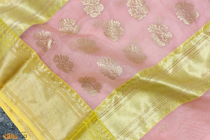 A diligently hand woven 100% Chanderi silk saree from Madhya Pradesh.   An intricately hand woven light pink saree is embellished with the traditional motifs of khad and chataai border. The minimal yet vivacious saree is extremely lightweight and easy to style. Drape this classic ensemble for festive shenanigans and family outings.