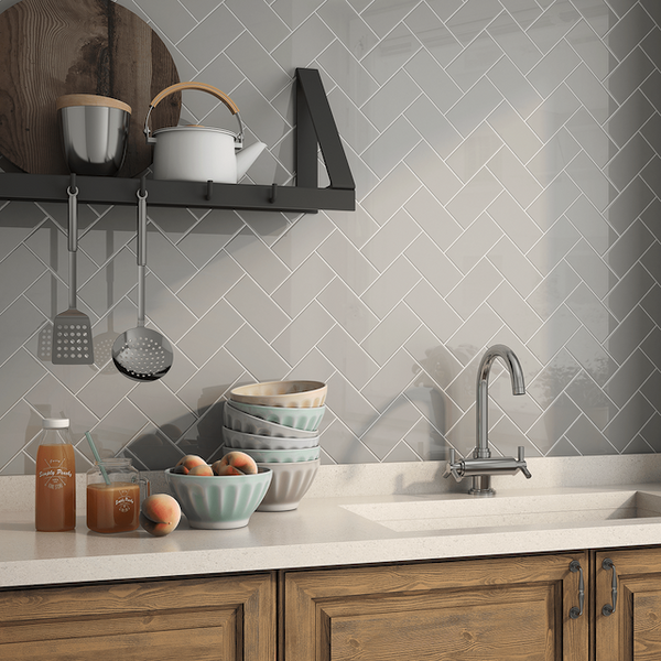 Subway tile on a kitchen backsplash laid out in a herringbone pattern