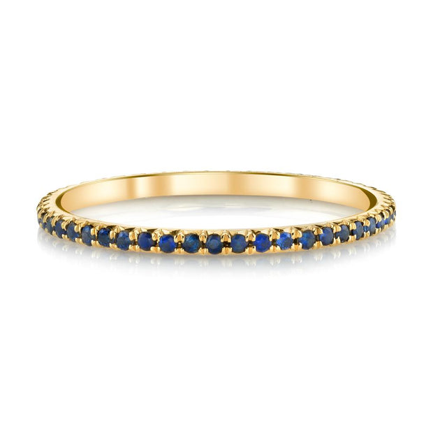 Yellow gold blue sapphire eternity band