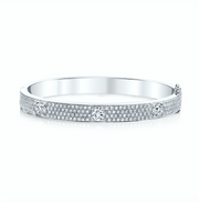 PAVE OVAL BRACELET WITH THREE ROUND DIAMONDS