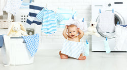 7 Lessons All New Moms Learn The Hard Way About Washing Baby Clothes