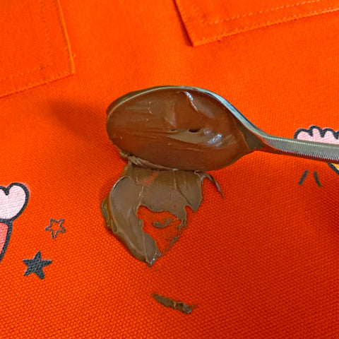 remove chocolate stain with a spoon