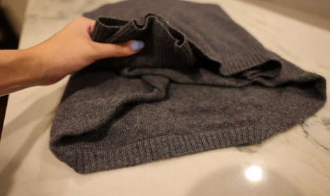 folding cashmere and prepping to store
