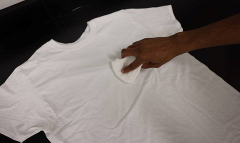 rubbing deodorant stain with washcloth